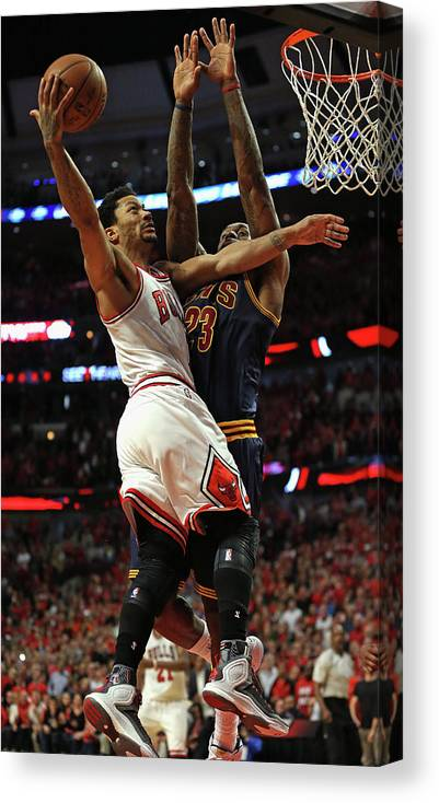 Chicago Bulls Canvas Print featuring the photograph Cleveland Cavaliers V Chicago Bulls - by Jonathan Daniel
