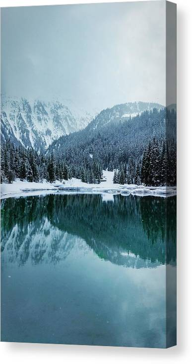 Tranquility Canvas Print featuring the photograph Reflection Of Mountains In Lake During Winter by Rmi Seznec / EyeEm