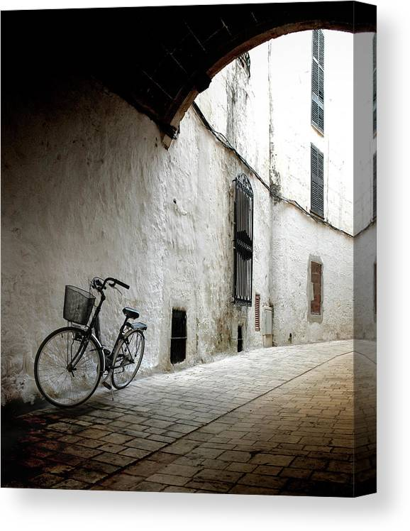 Tranquility Canvas Print featuring the photograph Bicycle Leaning Wall by Antonio R. Ramos