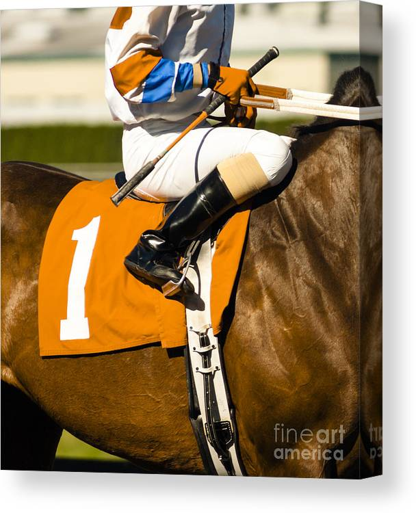 Equestrian Canvas Print featuring the photograph Jockey Rides Horse Along Track by Christopher Boswell