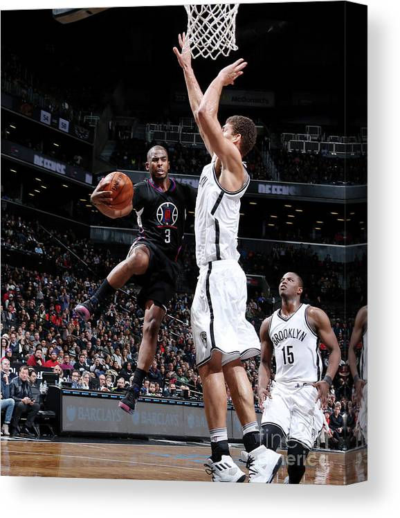 Nba Pro Basketball Canvas Print featuring the photograph Brook Lopez and Chris Paul by Nathaniel S. Butler