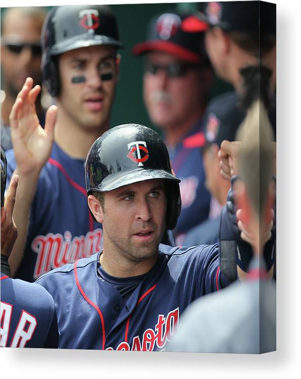 Joe Mauer Canvas Print featuring the photograph Joe Mauer, Trevor Plouffe, and Brian Dozier by Ed Zurga