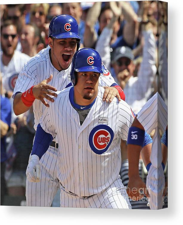 Three Quarter Length Canvas Print featuring the photograph Kyle Schwarber and Willson Contreras by Jonathan Daniel