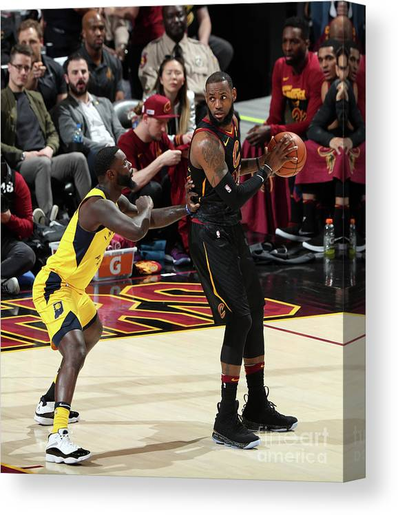 Playoffs Canvas Print featuring the photograph Lance Stephenson and Lebron James by Nathaniel S. Butler