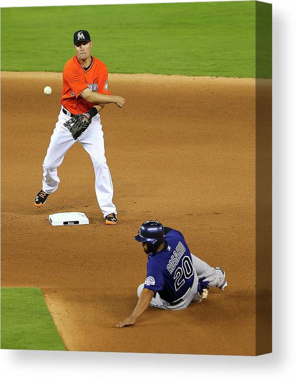 Double Play Canvas Print featuring the photograph Wilin Rosario by Mike Ehrmann