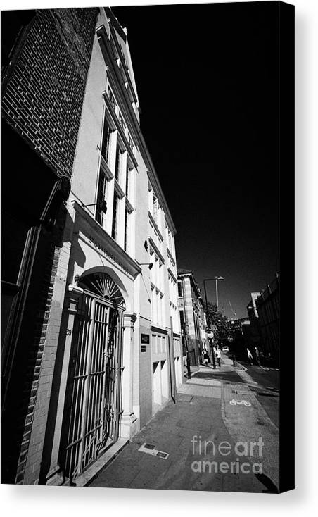 Saint Canvas Print featuring the photograph st saviours house home to united st saviours charity union street London England UK by Joe Fox