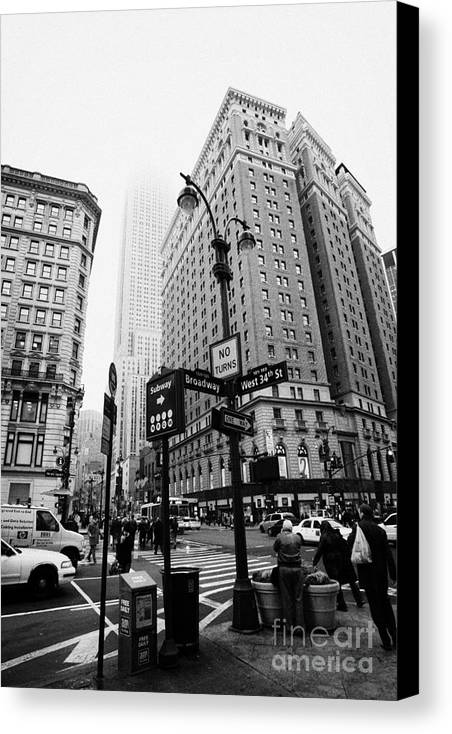 Usa Canvas Print featuring the photograph Busy Traffic Junction Of West 34th Street St And Broadway With Empire State Building Shrouded Mist by Joe Fox