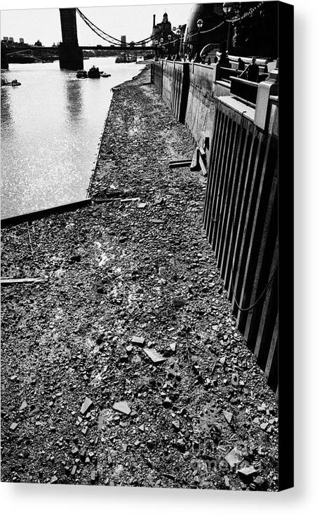 Mud Canvas Print featuring the photograph mud banks of the river thames and reinforced pilings at southwark London England UK by Joe Fox