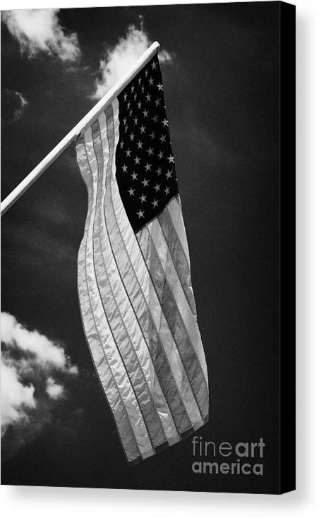 American Canvas Print featuring the photograph Us American Flag On Flagpole Against Blue Cloudy Sky Usa by Joe Fox