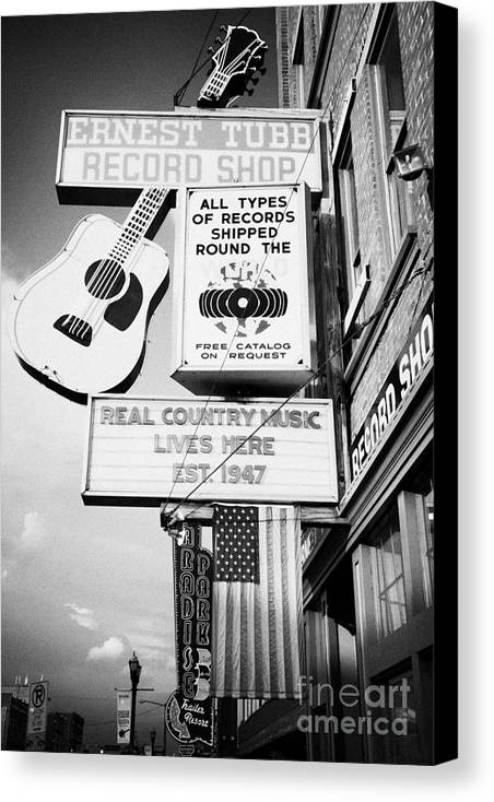 Broadway Canvas Print featuring the photograph ernest tubbs record shop on broadway downtown Nashville Tennessee USA by Joe Fox