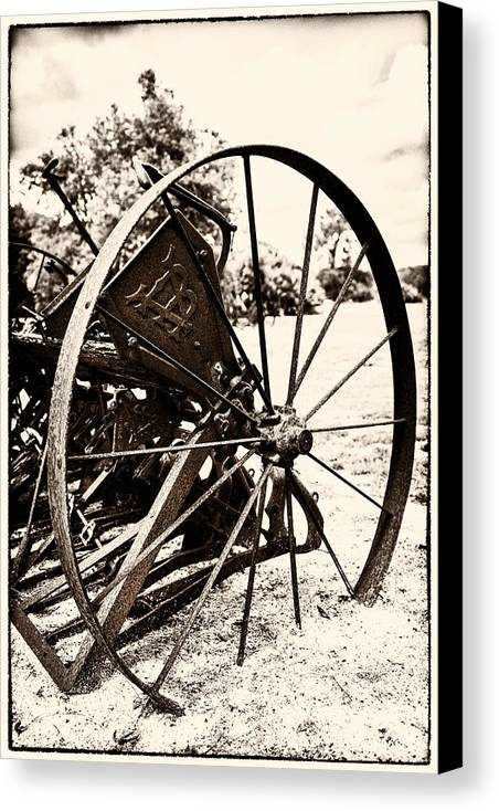 Farm Equipment Canvas Print featuring the photograph Some Wheels Stop Turning 1 by Karen Hanley Colbert