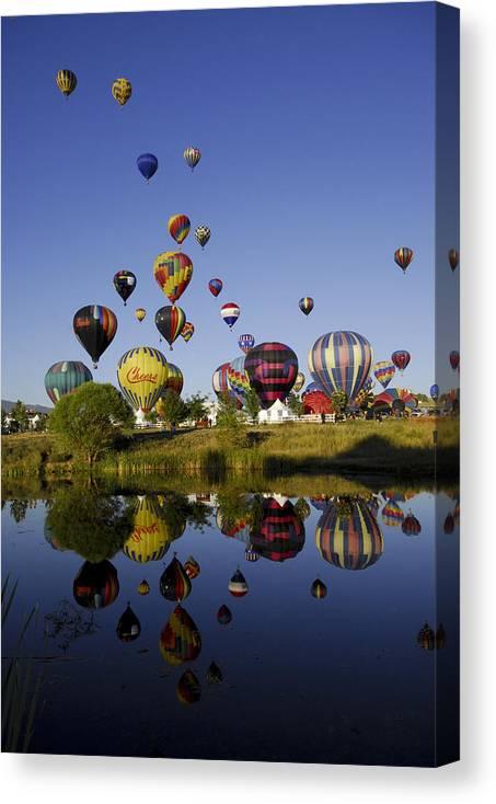 Balloon Canvas Print featuring the photograph Hot Air Balloon Mass Ascension by Owen Ashurst