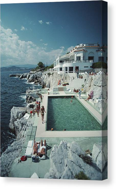 People Canvas Print featuring the photograph Hotel Du Cap Eden-roc by Slim Aarons