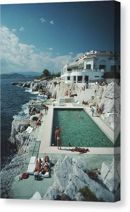 Recreational Pursuit Canvas Print featuring the photograph Eden-roc Pool by Slim Aarons