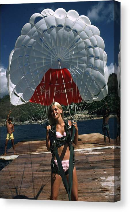 Recreational Pursuit Canvas Print featuring the photograph Paraglider by Slim Aarons