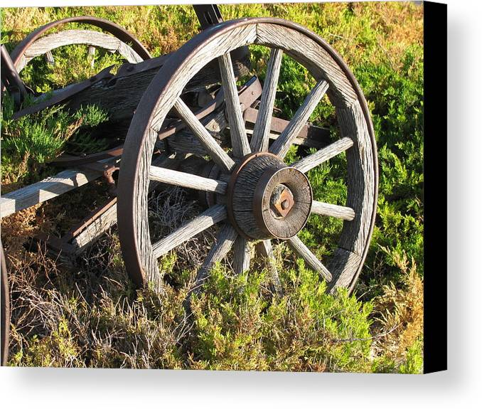 Transportation Canvas Print featuring the photograph Wagon Wheels by Steven Parker