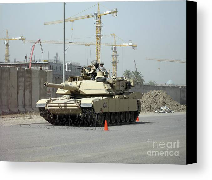 Baghdad Canvas Print featuring the photograph A M1 Abram Sits Out Front Of The New by Terry Moore