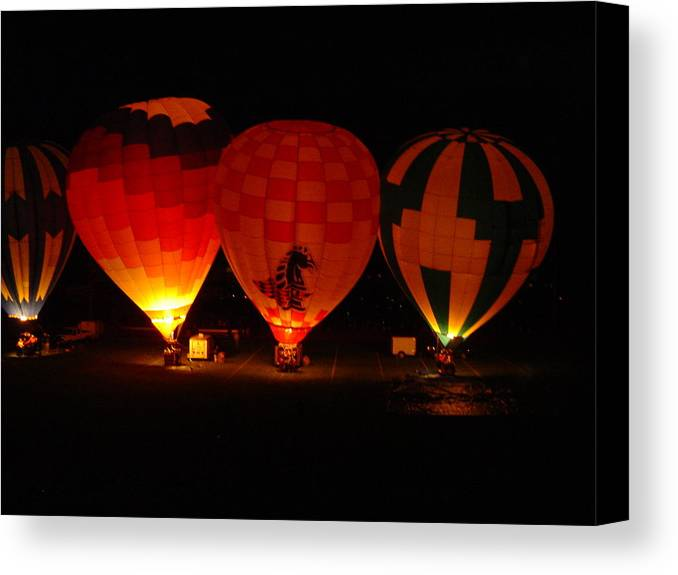 Hot Canvas Print featuring the photograph Balloons At Night by Michael Merry