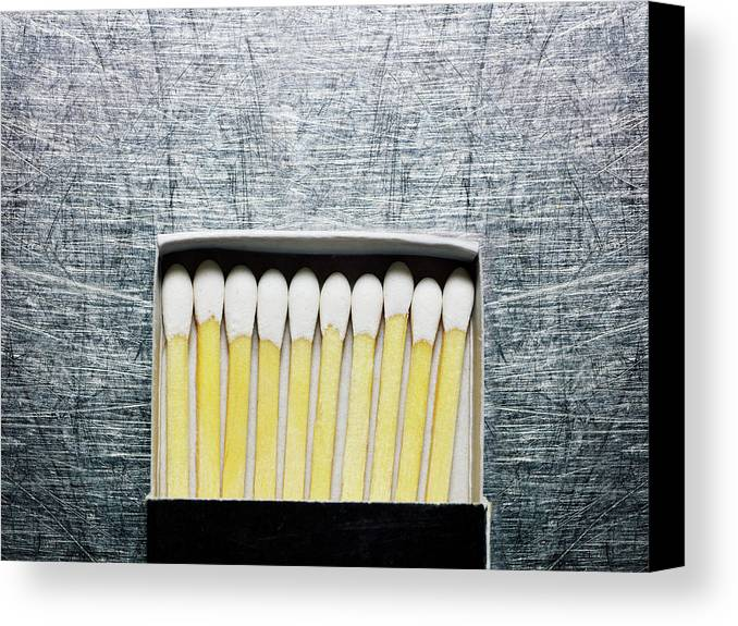 Horizontal Canvas Print featuring the photograph Box Of Wooden Matches On Stainless Steel. by Ballyscanlon