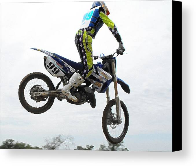 Dirtbike Canvas Print featuring the photograph Fly'n by Darrell Moseley