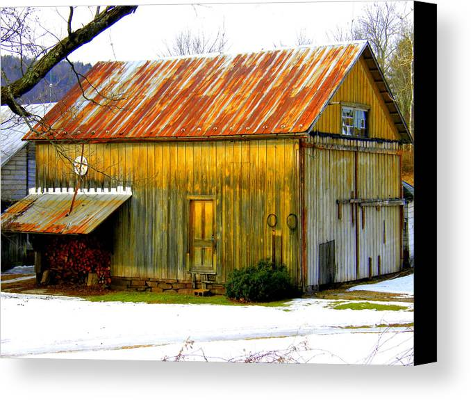 Tin Roof Canvas Print featuring the photograph Old Yellow Barn by Sherry Dulaney
