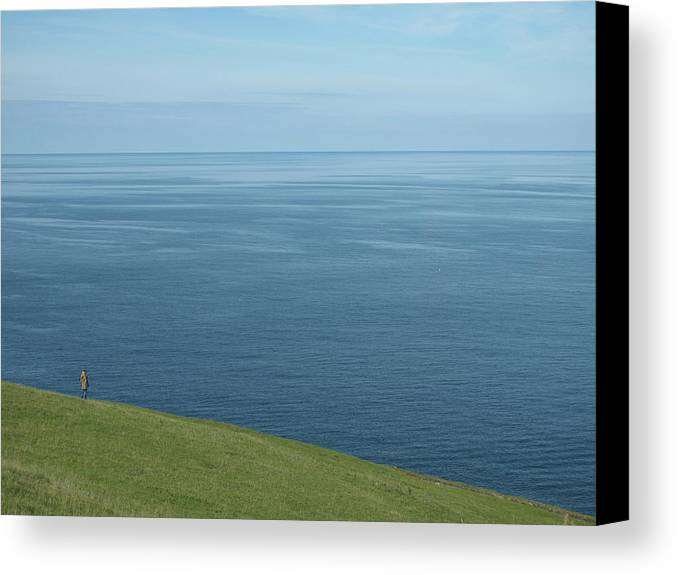 Horizontal Canvas Print featuring the photograph Person Looking Out To Sea In Cornwall by Thepurpledoor