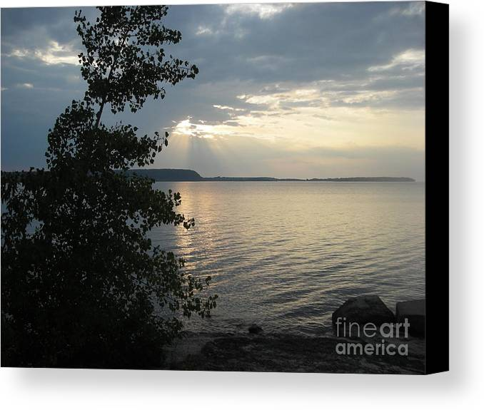 Dusk Canvas Print featuring the photograph Sunset In Door County by Snapshot Studio