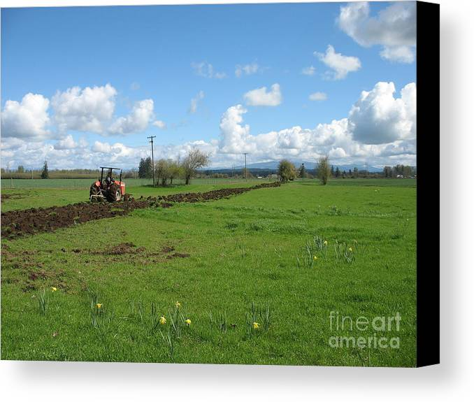 Tractor Canvas Print featuring the photograph Breaking Ground by Juli House