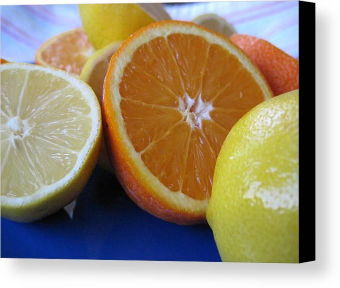 Citrus Canvas Print featuring the photograph Citrus On Blue Plate by Kim Pascu