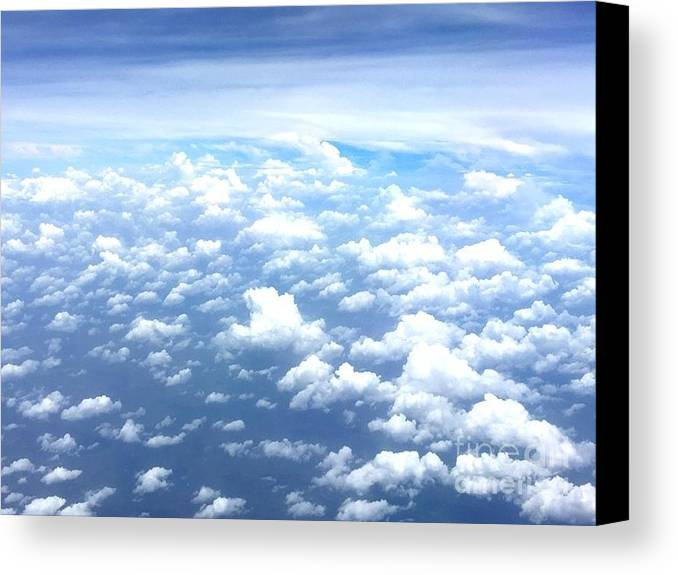 This Is A Photo Of Clouds Over The Atlantic Ocean From A Jet Plane. Canvas Print featuring the photograph Clouds Over The Ocean by William Rogers