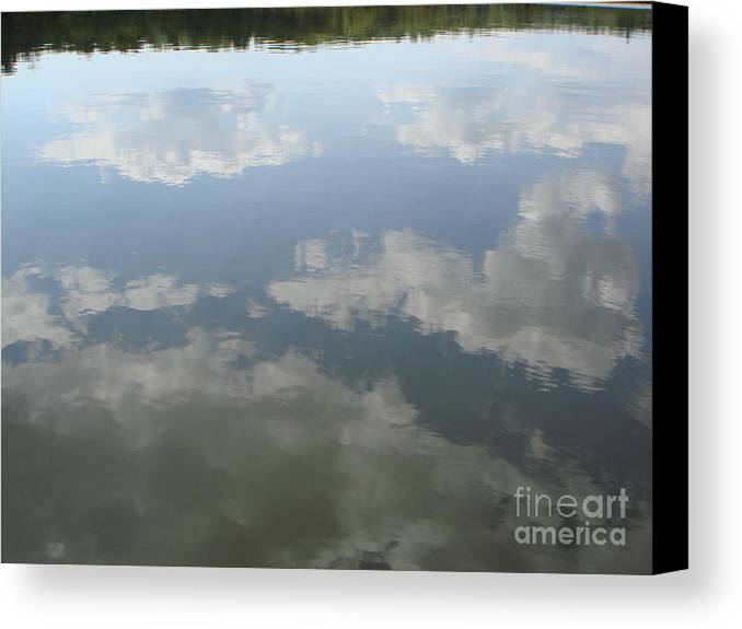 Sky Canvas Print featuring the photograph Clouds Reflection by PJ Cloud