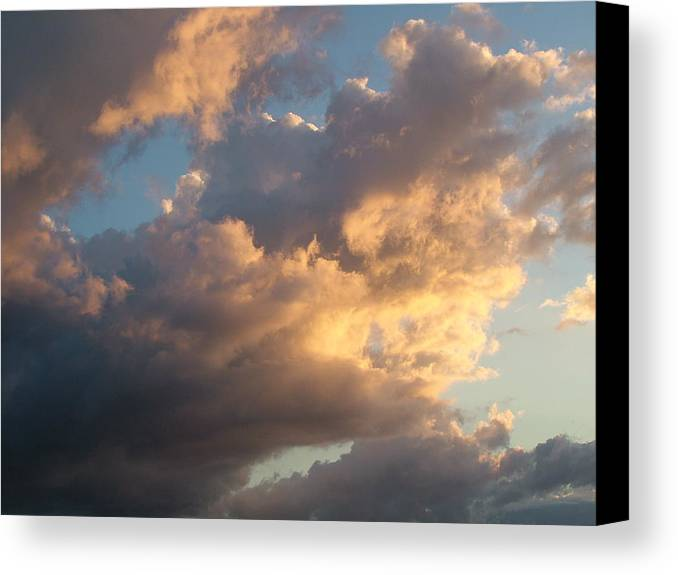 Clouds Canvas Print featuring the photograph Dramatic Sweeping Clouds by John Loyd Rushing