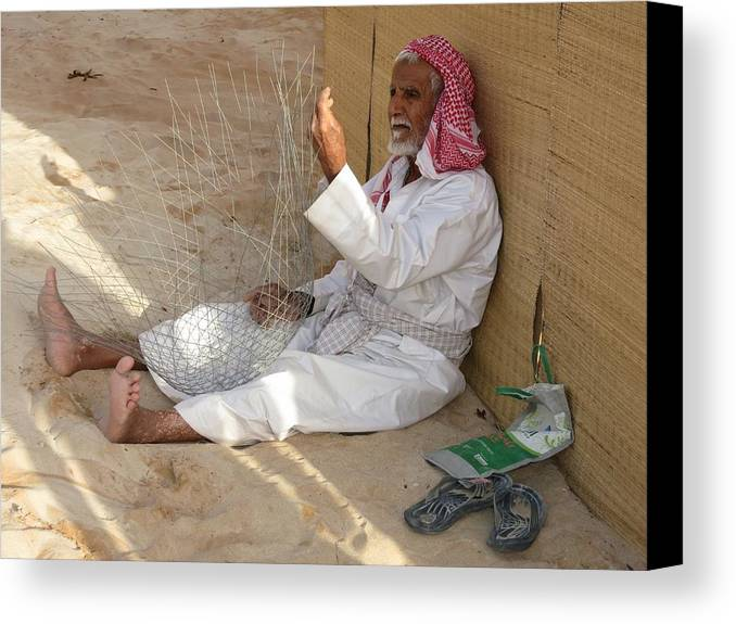 Uae Canvas Print featuring the photograph Fish Trap Craftsman by Mark Sellers