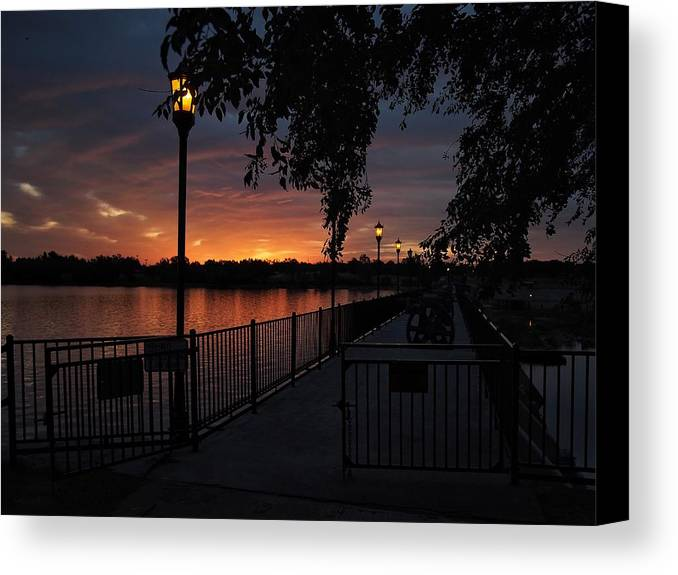 Lake Overholser Canvas Print featuring the photograph Lamplight And Daybreak by Buck Buchanan