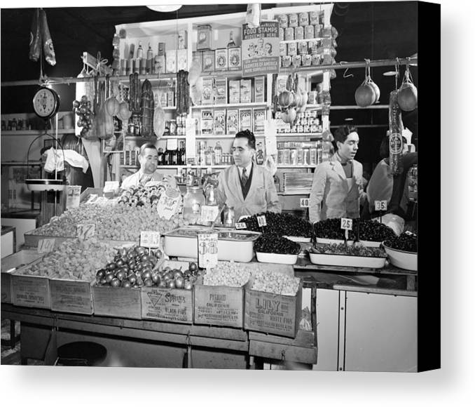 1940s Canvas Print featuring the photograph New York - Italian Grocer In The First by Everett