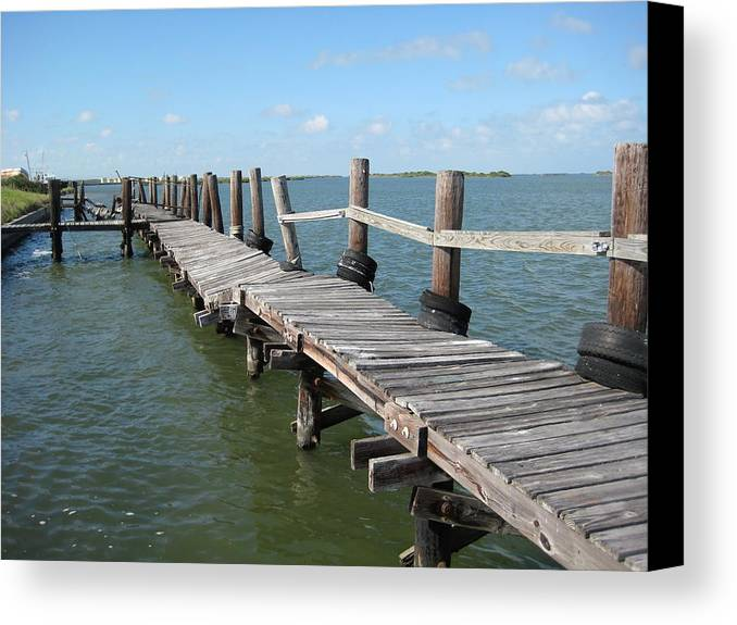 Marine Canvas Print featuring the photograph Old Pier by Wendell Baggett