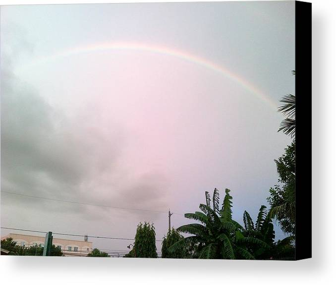 Rrainbow Canvas Print featuring the photograph The Rainbow by Pamela Abeleda