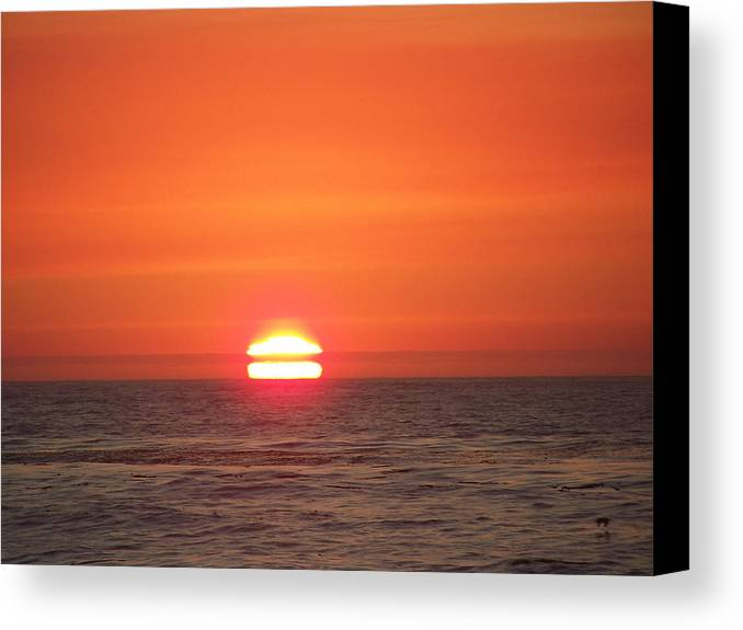 Sunsets Canvas Print featuring the photograph Red Skies At Night by Maggie Cruser