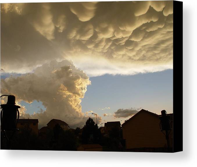 Clouds Canvas Print featuring the photograph Swirling Clouds by Karen Freeman