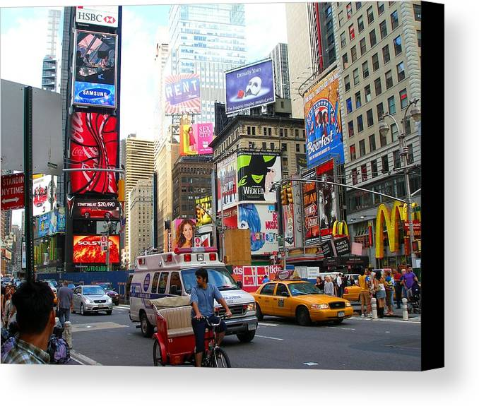 Downtown Canvas Print featuring the photograph Times Square New York by Candace Garcia