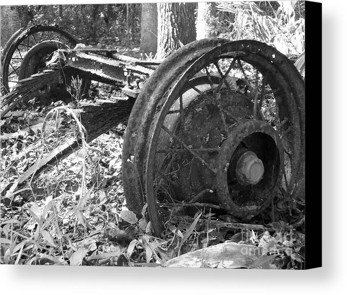 Wheel Canvas Print featuring the photograph Turning by Stephanie Richards