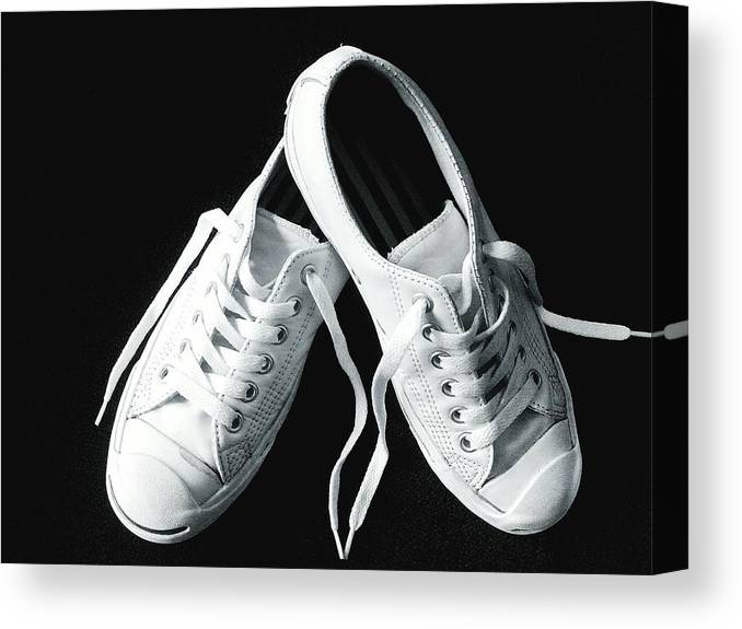 8eec3b25d4200 Two Objects Canvas Print featuring the photograph Close-up Of White Canvas  Shoes On Black