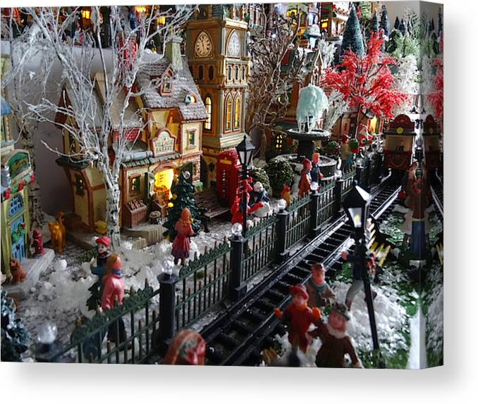 Christmas Model Railway.Image Of Model Christmas Village With Miniature Railway People Winter Scene Canvas Print