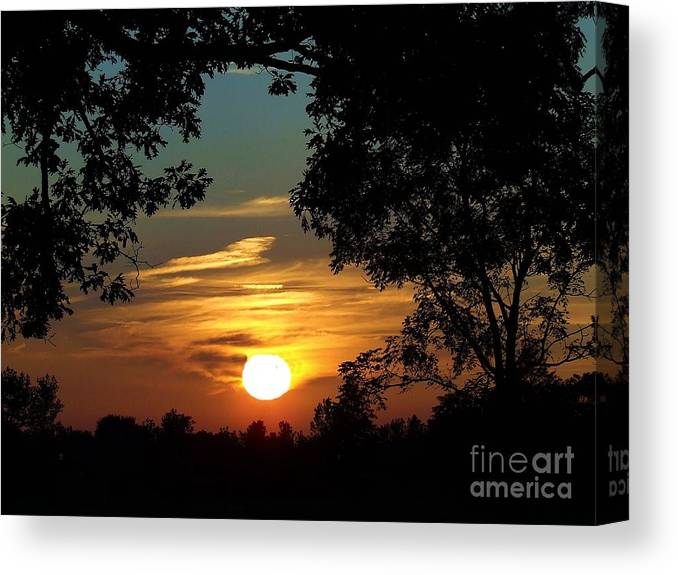 Spetacular Canvas Print featuring the photograph Is It Sun Up Or Sun Down by Scott B Bennett