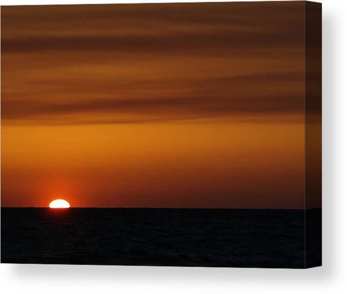 Sunset Canvas Print featuring the photograph Sun Setting In The Water by Jo Jurkiewicz