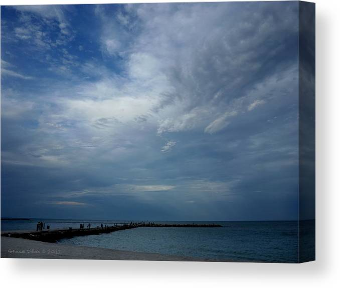 Sun Rays Canvas Print featuring the photograph Clouds Over The Jetty by Grace Dillon
