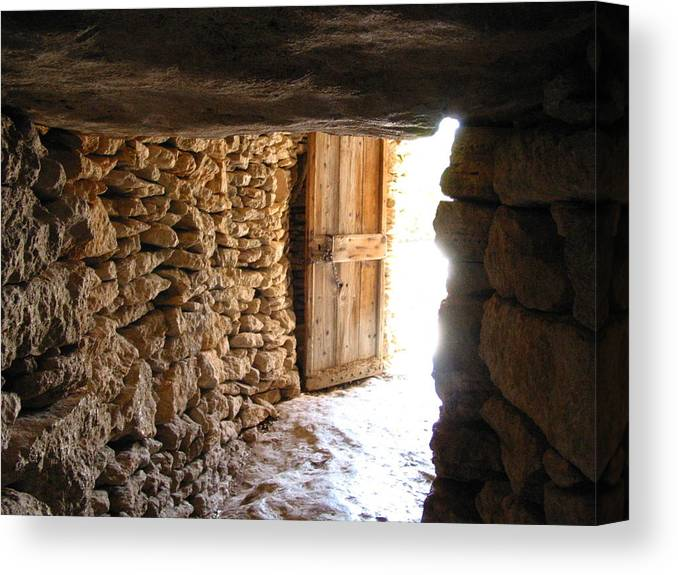 Stone Canvas Print featuring the photograph The Cave by David Dalrymple