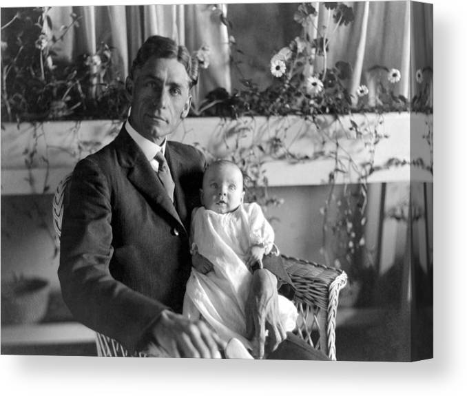 Man Canvas Print featuring the photograph Man Male Holding Baby 1910s Black White Archive by Mark Goebel