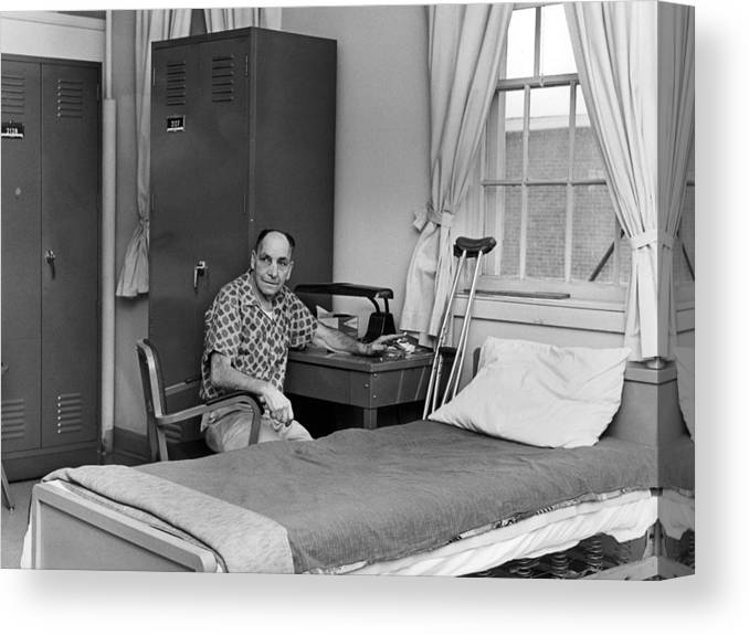 Patient Canvas Print featuring the photograph Patient Sitting Desk In Hospital Room Circa 1960 by Mark Goebel