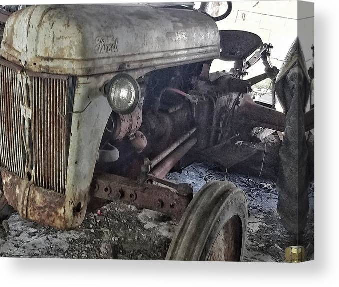 Abandon Canvas Print featuring the photograph Abandoned Tractor by Ed Lumbert